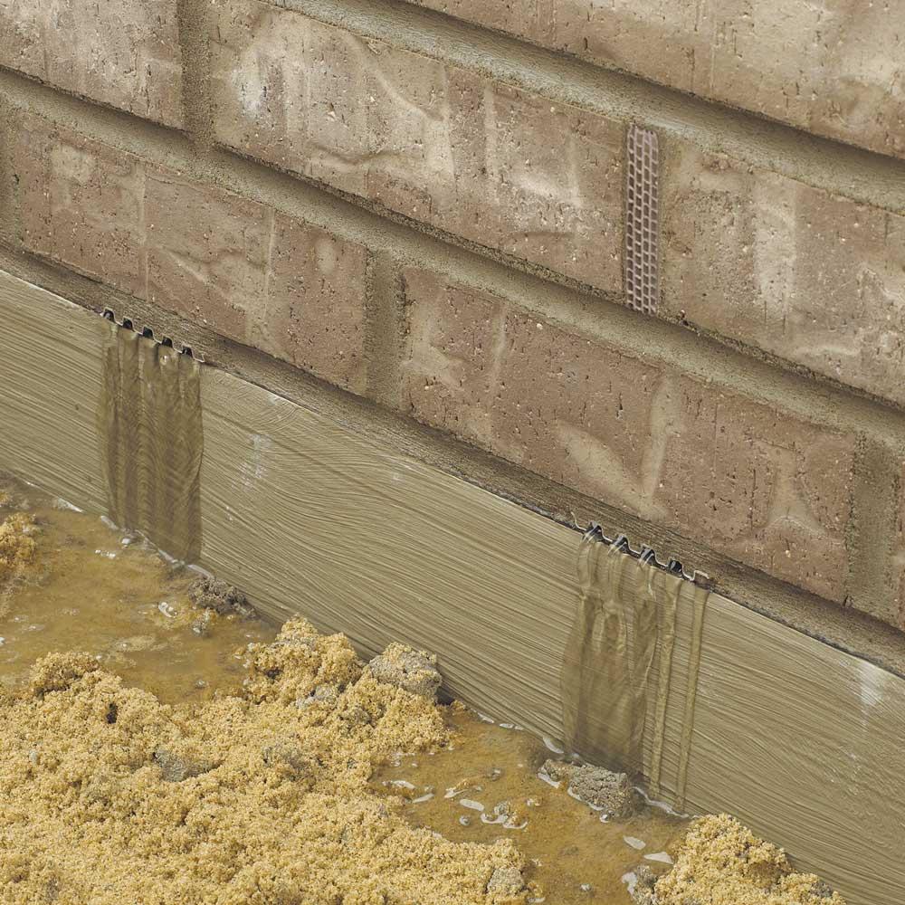Weeps draining brick wall